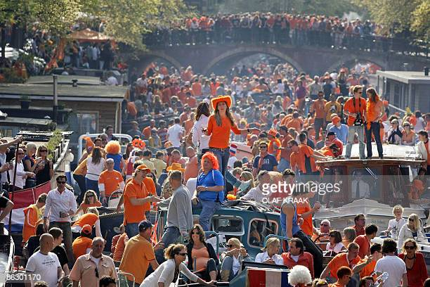 Thousands of people celebrate Queensday on boats in the canals of Amsterdam, on April 30, 2009. A car slammed into Dutch Queensday festival-goers in...