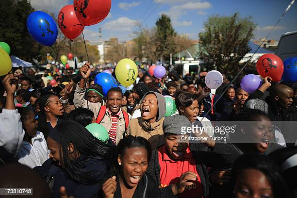 Thousands of people celebrate the 95th birthday of their 'Father of the Nation' Nelson Mandela outside the Mediclinic Heart Hospital where he is...