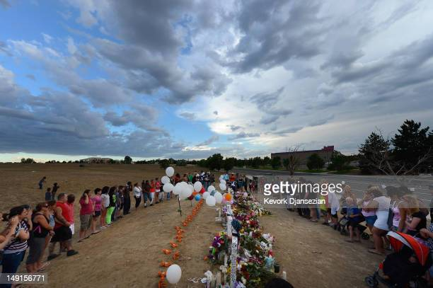 Thousands of people continue to visit the makeshift memorial for the 12 movie theater shooting victims built across the street from the Century 16...