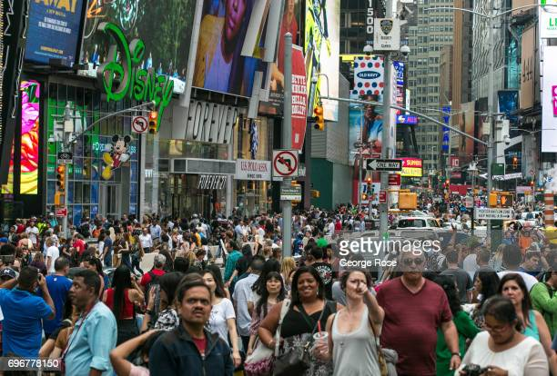 Thousands of people crowd into Times Square at the corners of Broadway and 7th Avenue on June 10 2017 in New York New York With a full schedule of...