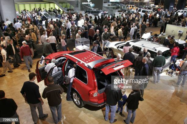 Thousands of people crowd the display floor at the opening of the 2007 North American International Auto Show January 13, 2007 in Detroit, Michigan....