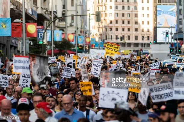 Thousands of people demanding to welcome refugees during a demonstration against immigration policies