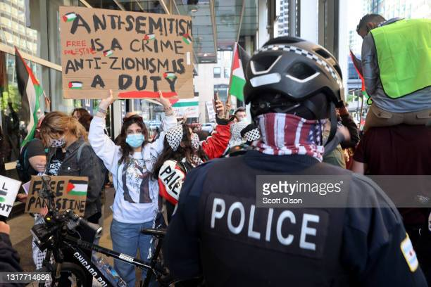 Thousands of people demonstrate outside of a building that houses the Israeli consulate to protest Israeli airstrikes in the Gaza Strip on May 12,...