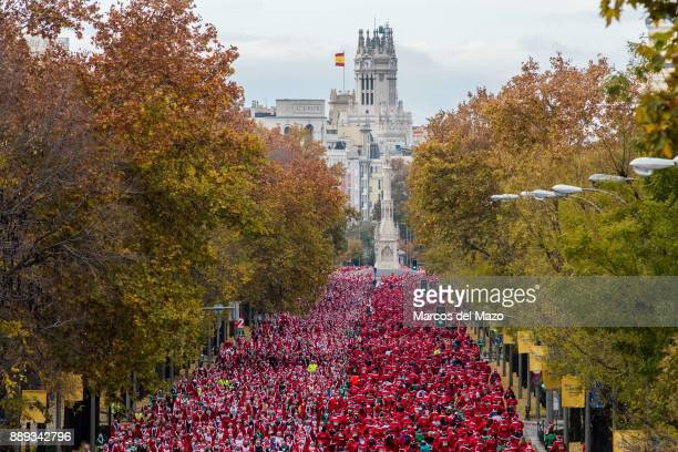 Thousands of people dressed like Santas participate in the annual Santa Claus run