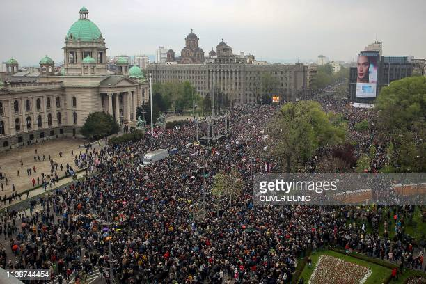 Thousands of people from all over Serbia gather in front of the National Assembly building in central Belgrade on April 13 to protest against Serbian...