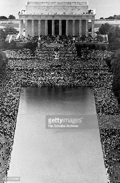 Thousands of people gather at the Lincoln Memorial and around its reflecting pool to hear featured speakers at the conclusion of the March on...