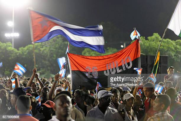 Thousands of people gather in Revolution Plaza for a memorial event for former Cuban President Fidel Castro December 3 2016 in Santiago de Cuba Cuba...
