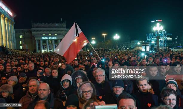 Thousands of people gather in Warsaw under the slogan Stop Hatred on January 14 2019 to protest against violence and honour Pawel Adamowicz the late...
