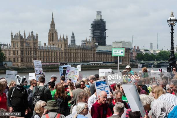 Thousands of people gather in Westminster to lobby MPs to take decisive action on climate change and environmental destruction on 26 June 2019 in...