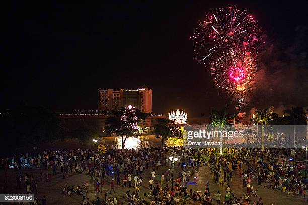 Thousands of people gather on the riverside to watch the fireworks display during the first night of the Water Festival on November 13 2016 in Phnom...