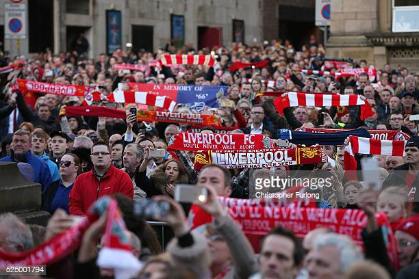 Thousands of people gather outside Liverpool's Saint George's Hall as they attend a vigil for the 96 victims of the Hillsborough tragedy on April 27...