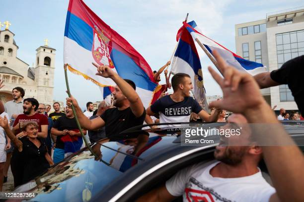 Thousands of people gather outside the Cathedral of the Resurrection to celebrate a day after a coalition of Serbian nationalist and pro-Russian...
