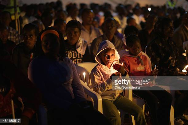 Thousands of people gathered for a candlelight commemoration ceremony the NyanzaKicukiro genocide memorial 20 years after 2000 people were killed by...