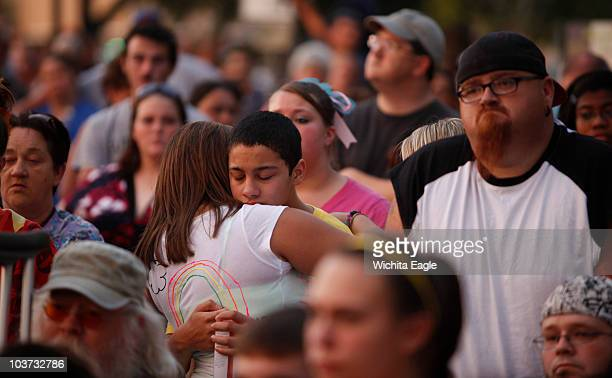 Thousands of people gathered for a candlelight prayer vigil in downtown Great Bend Kansas to honor the memory of 14yearold Alicia DeBolt Many of her...