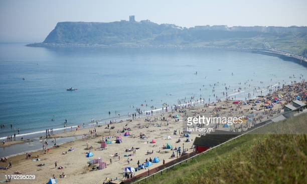 Thousands of people head to Scarborough North Bay beach on August 26, 2019 in Scarborough, United Kingdom. Temperatures have climbed over 30C in...
