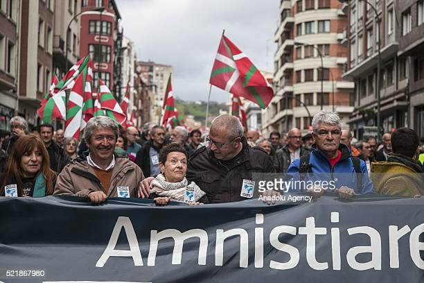 Thousands of people hold banners and flags as they demonstrate in the streets of Bilbao on April 17 2016 calling for the return of prisoners and...