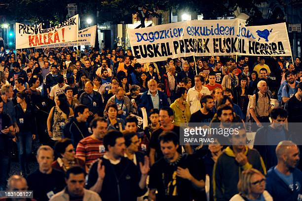 Thousands of people hold banners demanding repatriation for Basque prisoners on October 4 2013 during a demonstration called by pro independence...