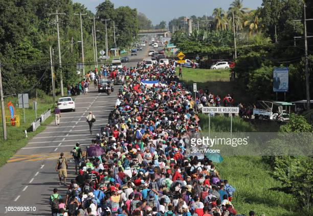 Thousands of people in a migrant caravan walk into the interior of Mexico after crossing the Guatemalan border on October 21 2018 near Ciudad Hidalgo...