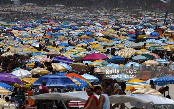 Thousands of people in Rio de Janeiro turn to Ipanema beach to stand the 40 degrees Celsius heat on December 28 2016 The first summer days in Rio de...