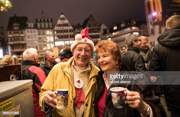 Thousands of people including Werner and Sissy gather on the Roemerberg to listen to the traditional Grosses Stadtgelaeute the ringing of the 50...