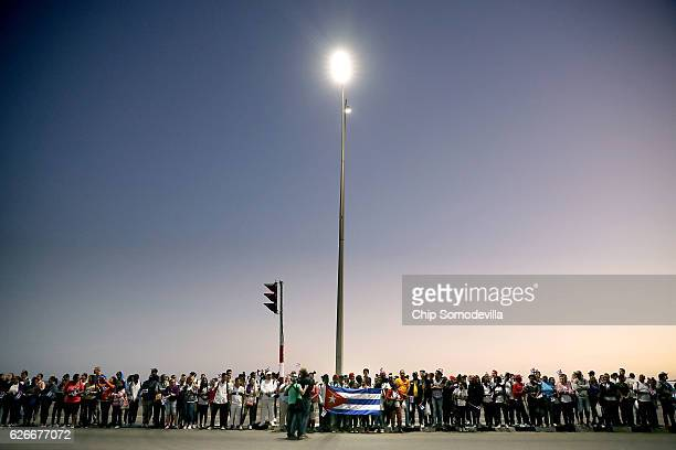 Thousands of people line the famous Malecon seaside boulevard waiting to pay their respects to former Cuban President Fidel Castro as his remains are...