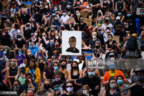 Thousands of people listen as Denver Broncos players speak at a protest for the death of George Floyd on June 6, 2020 in Denver, Colorado. This is...