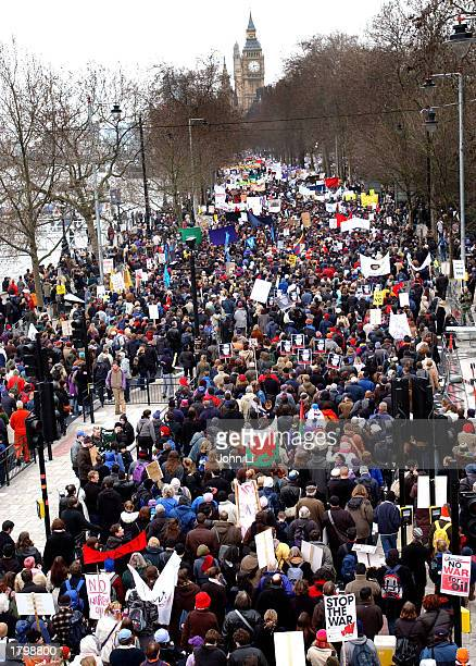 Thousands of people march along the Embankment towards Hyde Park as they participate in an antiwar protest march February 15 2003 in London England...