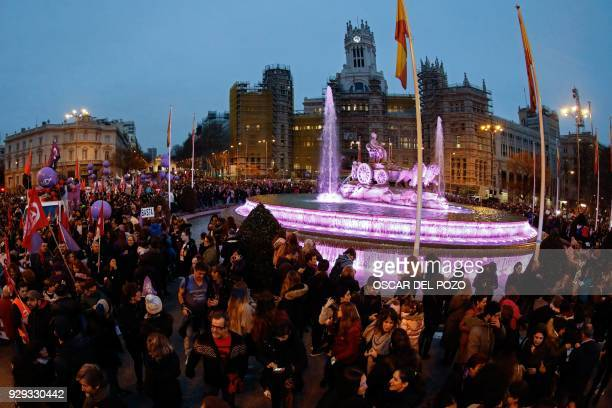 Thousands of people march down Alcala street and Cibeles square in Madrid on March 8 2018 during a one day strike to defend women's rights on...