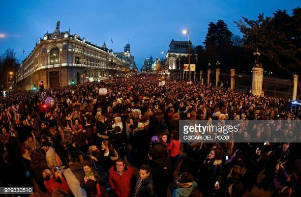 Thousands of people march down Alcala street in Madrid on March 8 2018 during a one day strike to defend women's rights on International Women's Day...