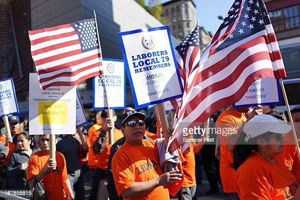 Thousands of people march down Broadway on International Workers Day or Labor Day on May 1 2013 in New York City The annual global gathering of...