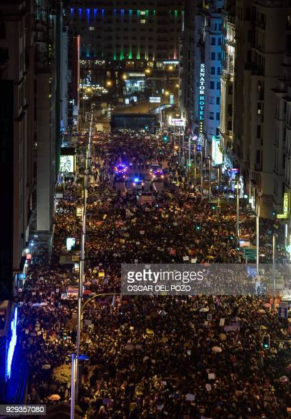 Thousands of people march down Gran Via street in Madrid on March 8 2018 during a one day strike to defend women's rights on International Women's...