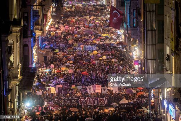 Thousands of people march down Istanbul's famous Istiklal street during a rally for International Women's Day on March 8 2018 in Istanbul Turkey...