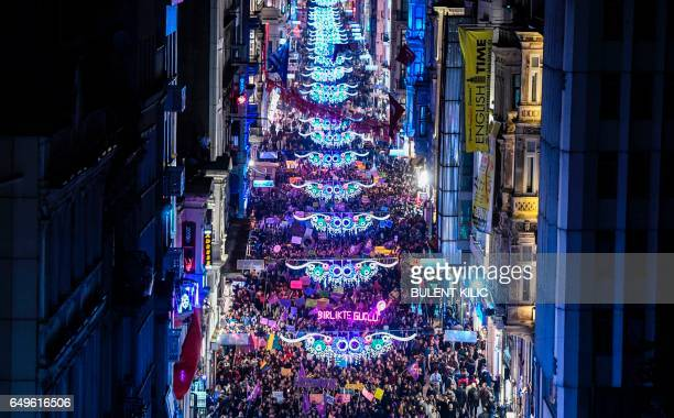 Thousands of people march down Istiklal Avenue during a feminist night march to mark International Women's Day in Istanbul on March 8 2017 / AFP...