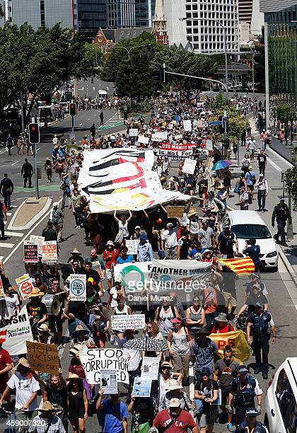 Thousands of people march during a protests against G20 summit on November 15 2014 in Brisbane Australia World leaders have gathered in Brisbane for...