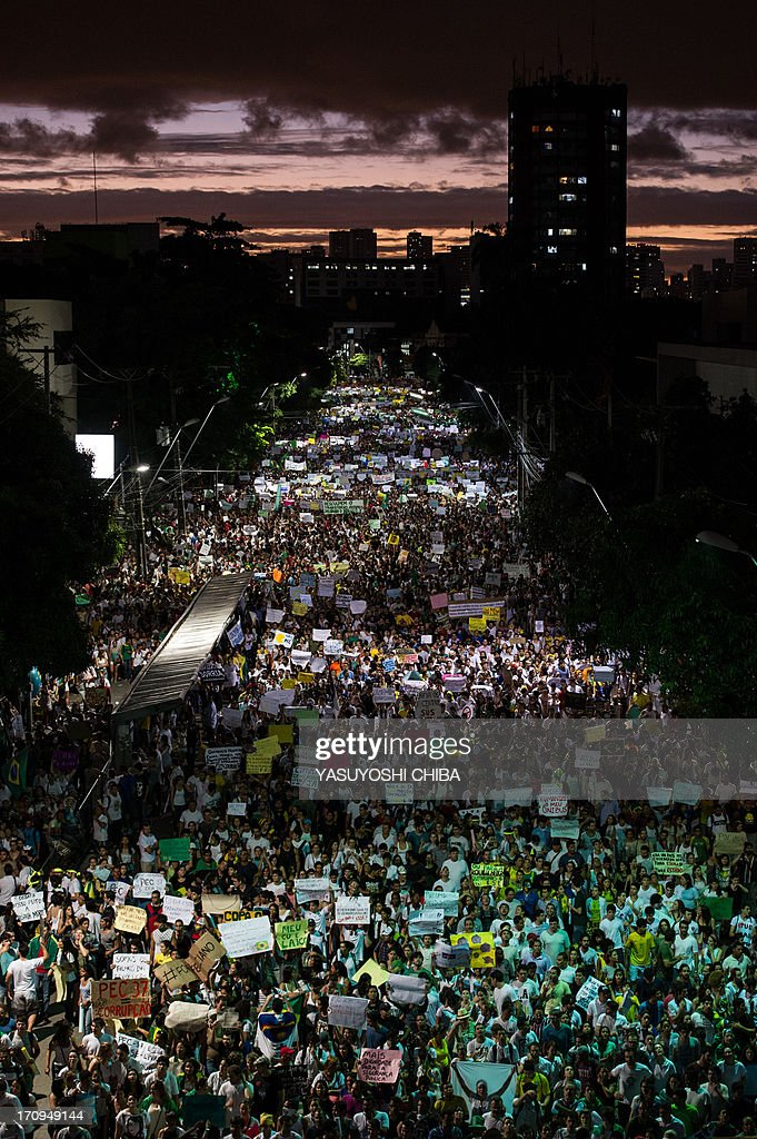 Thousands of people march in the center of Recife, state of Pernambuco, Brazil, on June 20, 2013, during a protest of what is now called the 'Tropical Spring' against corruption and price hikes. Brazilians took to the streets again on a new day of mass nationwide protests, demanding better public services and bemoaning massive spending to stage the World Cup. More than one million people have pledged via social media networks to march in 80 cities across Brazil, as the two-week-old protest movement -- the biggest seen in the South American country in 20 years -- showed no sign of abating.
