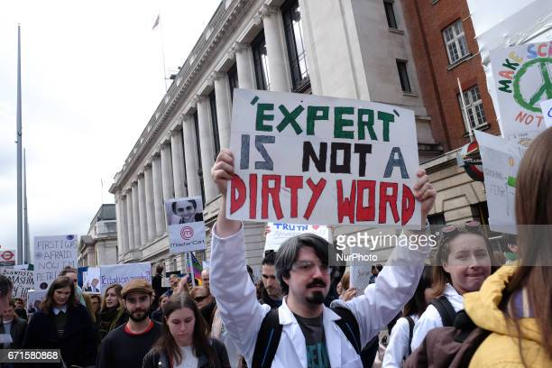 Thousands of people march though Central London UK on Earth Day on 22 April 2017 to protest against what they see as a threat to experts evidence and...