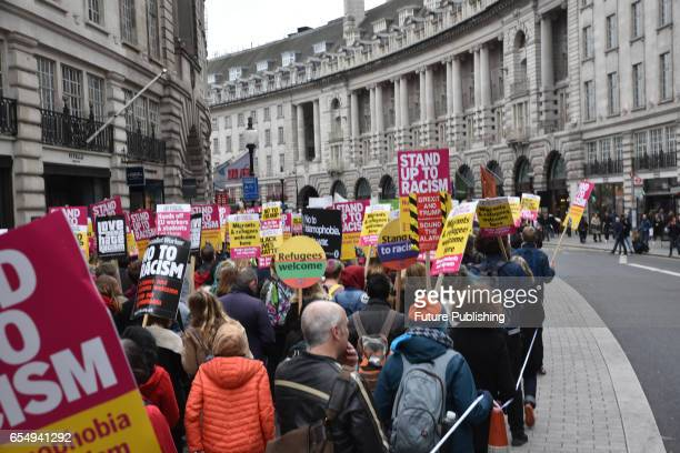 Thousands of people march through central London to protest against racism on March 18 2017 in London England The march was part of the UN antiracism...