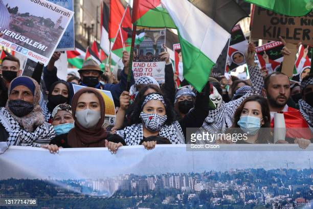 Thousands of people march through downtown to the Israeli consulate to protest Israeli airstrikes in the Gaza Strip on May 12, 2021 in Chicago,...
