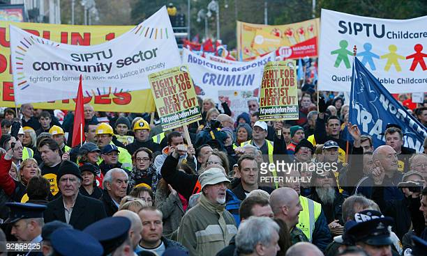 Thousands of people march through the streets of Dublin Ireland on November 6 2009 Tens of thousands of angry demonstrators rallied across Ireland on...
