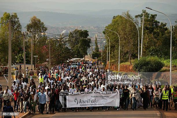 Thousands of people march to a commemoration ceremony at the NyanzaKicukiro genocide memorial 20 years after 2000 people were killed by the extremist...
