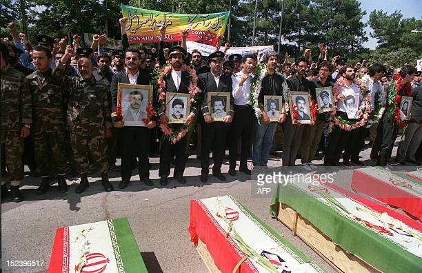 Thousands of people mourn 07 July 1988 in Tehran during the funeral service for those who died when an Iran Air passenger jet was shot down over the...