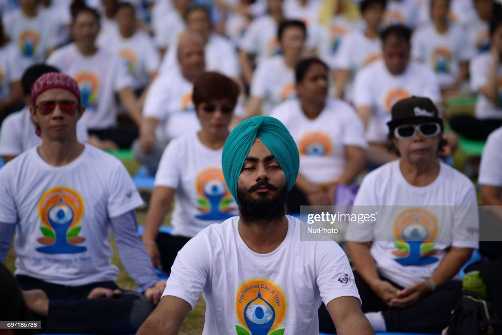 Thousands of people participate in a yoga exercise at Chulalongkorn University field, marking the International Day of Yoga in Bangkok, Thailand. June 18, 2017. International Day of Yoga event at Chulalongkorn University aims to promote yoga as a way to improve physical strength, flexibility and mental well-being it was an to join the people across the globe to celebrate the health benefits and peace of the ancient Indian traditon.