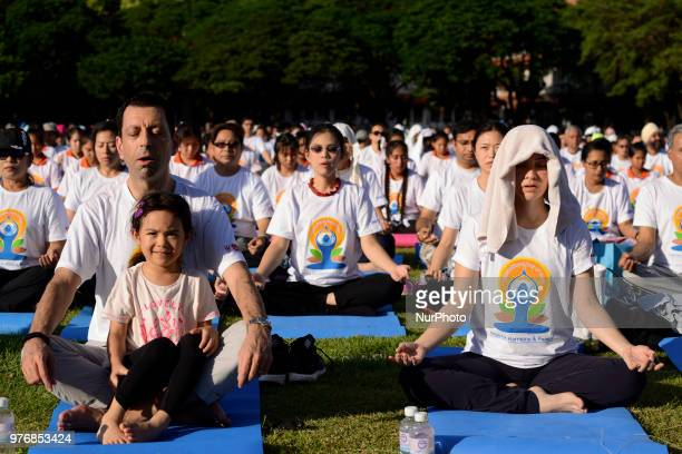 Thousands of people participate in a yoga exercise at Chulalongkorn University field marking the International Day of Yoga in Bangkok Thailand 17...