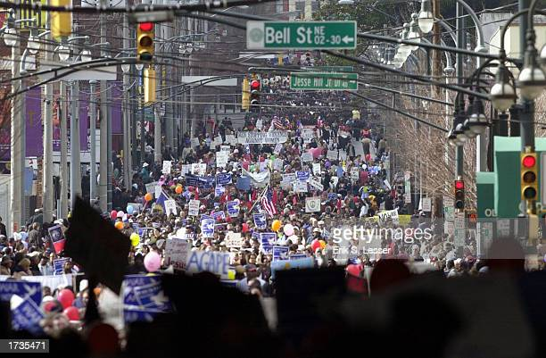 Thousands of people participate in the annual Rev Martin Luther King Jr Day March January 20 2003 in Atlanta Georgia Organizers used the march as a...