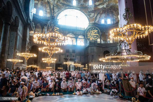 Thousands of people pray inside Hagia Sophia Mosque during the afternoon prayer after the official opening on July 24, 2020 in Istanbul, Turkey....
