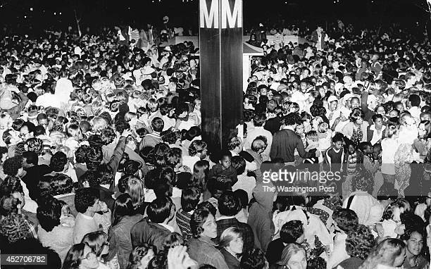 Thousands of people press their way into the Smithsonian Subway station after the Independence Day fireworks in Washington, DC on July 4, 1979.