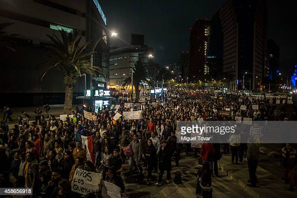 Thousands of people protest against Mexican president Enrique Pena Nieto during a spontaneous demonstration after Mexico's government announced on...