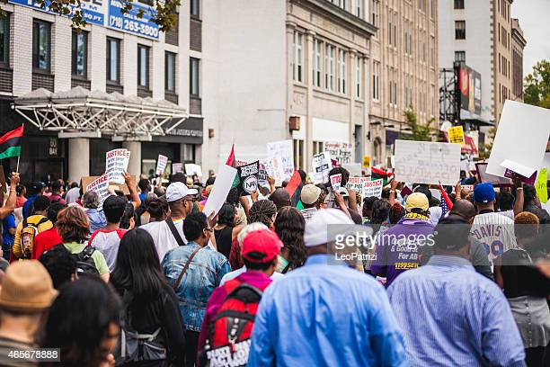 thousands of people protest against nypd in august 2014 - labor union stock pictures, royalty-free photos & images