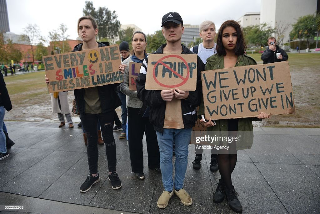 Thousands of people protest against the inauguration of the 45th President of the United States, Donald Trump under heavy rain in Downtown, Los Angeles, California, United States on January 20, 2017.