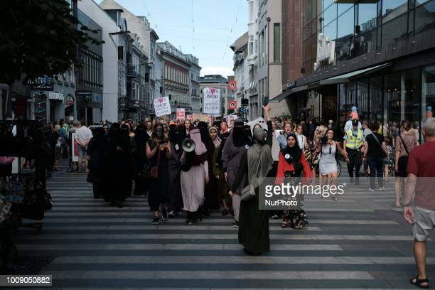 Thousands of people protest in Aarhus Denmark on August 1 2018 in defiance of the Danish Governments ban on the burka and niqab The nationwide...